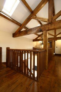 Three quarter king post truss used to create a stunning feature above the main staircase.